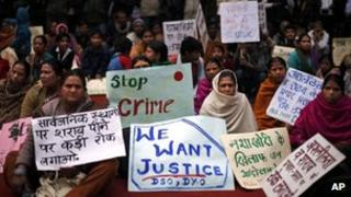 Group of demonstrators hold placards during a protest against the alleged inaction by the Indian government in the case of the gang rape of a 23-years old student in a bus in December