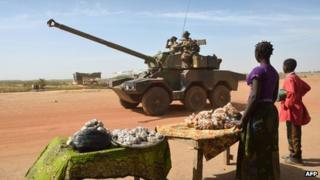 Malian people watch French troops in Diabaly on 23 January 2013
