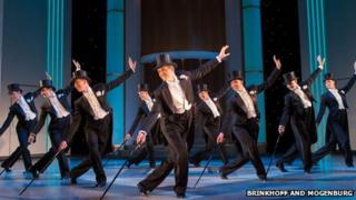 Tom Chambers (centre) with the male ensemble of Top Hat