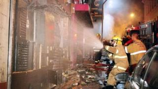 Firefighters try to put out a fire at the Kiss club in Santa Maria, Rio Grande do Sul, southern Brazil