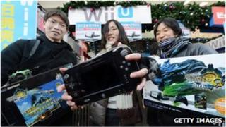 Shopper shows off her Wii-U purchase