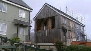 Wind damaged house
