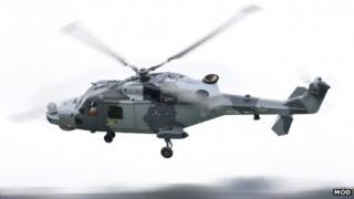 Royal Navy Wildcat Attack helicopter in flight, Wildcat HMA Mk2 maiden flight , Somerset, Jan 2013