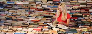 Woman reader among stacks of books at the Southbank Centre, London