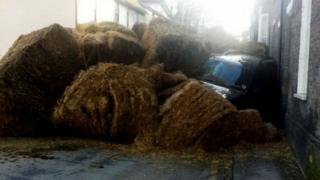 Bales fallen on car