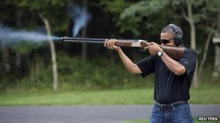 President Barack Obama shoots clay targets on the range at Camp David, Maryland, in this White House handout photo taken 4 August 2012