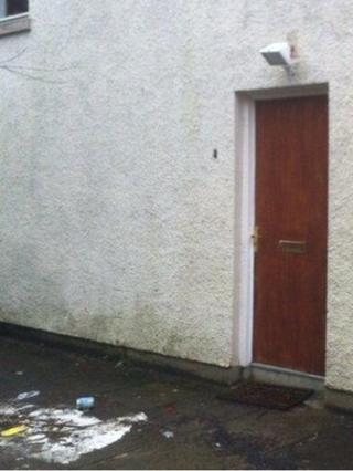 The bomb was left at the door of a flat