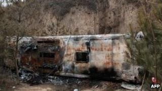 Burnt-out bus in Ningxian, Gansu province, on 2 February 2013