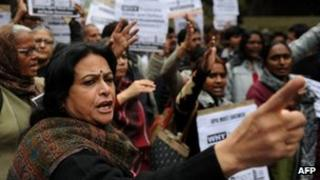 Indian activists shout slogans during a protest for the implementation of harsher punishments and quicker trials for rape cases in New Delhi on February 4,2013.