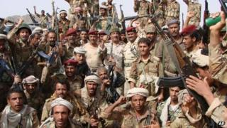 Army personnel pose after the end of three days of firefights with al-Qaeda fighters near the town of Shuqra in Yemen's southern province of Abyan (image provided by Yemeni Defence Ministry)