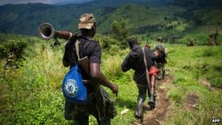 M23 rebels withdraw through the hills having left their position in the village of Karuba, eastern Democratic Republic of Congo, on 30 November 2012