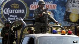 Troops at a checkpoint near the Acapulco house where the Spanish women were raped