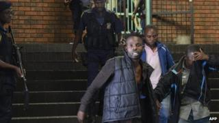 Alleged members of he Union of Nationalists for Renewal outside a court in Pretoria, South Africa - 7 February 2013