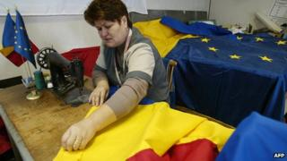 Worker sews Romanian flag in Bucharest (file image)