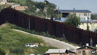 US Border Patrol vehicle in Arizona keeps watch along the fence on the border with Mexico. File photo