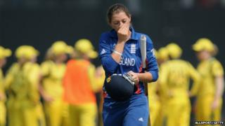 Sarah Taylor of England walks back after getting out during the super six match between England and Australia.