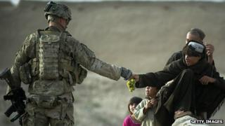 US soldier shares grapes with boys in Kandahar province (12 September 2012)