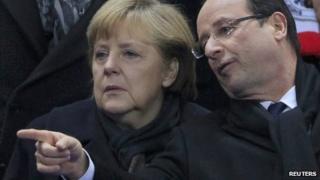 Angela Merkel and Francois Hollande at an international football friendly in France (6 February 2013)