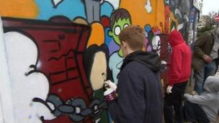 Spray painting in Brighton to highlight issue of teenage abuse