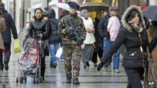 A French soldier patrols a street in Paris, 15 January