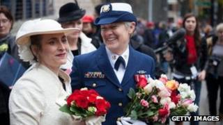 Nancy Monahan, right, a retired Coast Guard petty officer, shares a laugh with her wife, Deb Needham, after their wedding at City Hall in Seattle, Washington 9 December 2012