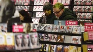 Shoppers in a branch of HMV
