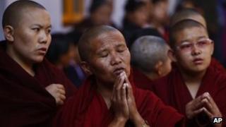 Exiled Tibetan monks praying at a Tibetan Monastery near Boudhanath Stupa, 13 February 2013