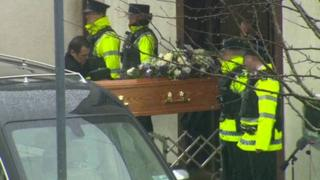 Constable Reynolds' coffin is carried into the church