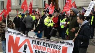 Protesters with flags and banners outside Southampton Civic Centre