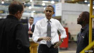 US President Barack Obama speaks to employees at a factory in Asheville, North Carolina 13 February 2013