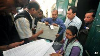 Election officials receive electronic voting machines before moving to their respective polling stations ahead of the Tripura state elections in Agartala, India, Wednesday, Feb. 13, 2013.