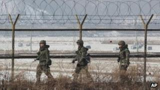 South Korean soldiers patrol the DMZ on 14 February 2013