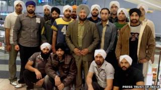 Surinder Pal Singh Oberoi with 17 Indian nationals he helped free