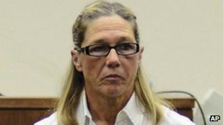 Rita Crundwell leaves a courtroom in Dixon 22 October 2012
