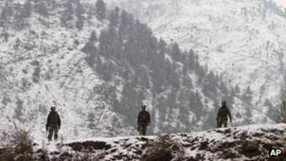 Indian army soldiers patrol near the Line of Control (LOC), the line that divides Kashmir between India and Pakistan, in Silikot some 130 Kilometers (81 miles) north of Srinagar, India, Thursday, Jan. 17, 2013.