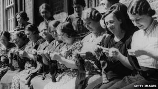 Women from South London knit socks for men fighting in WWII