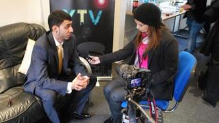 YouthTelevision volunteer interviewing a guest at the launch