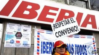 Workers demonstrate outside Iberia headquarters in Madrid