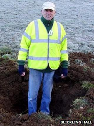 Man standing in small crater