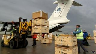 Oxfam aid being loaded on plane in 2004