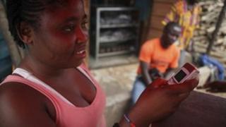 A girl at a telecentre kiosk in Sierra Leone