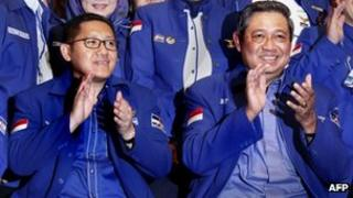 In this photograph taken on 17 February 2013, Democratic Party chairman Anas Urbaningrum (L) applauds during the party congress with Indonesian President Susilo Bambang Yudhoyono in Jakarta