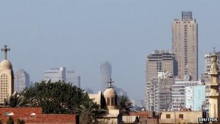 A mosque's minaret beside a Coptic church in Cairo (23 February 2013)