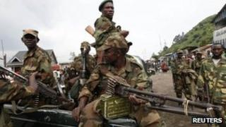 Rebels sit in a truck as they patrol a street in Sake, eastern DR Congo - 21 November 2012