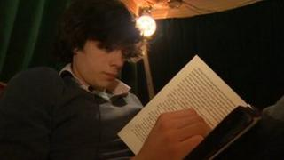 Nick Pryke reading a book