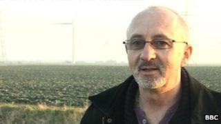 Steve Rashleigh, from Bicker, standing in front of the wind farm near his property.