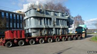 The generator transformer placed onto a low loader for transporting.