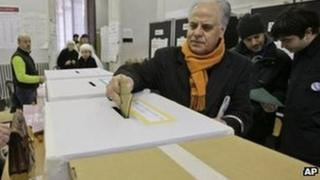 A man casts his ballot in a polling station in central Rome