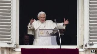 Pope Benedict XVI delivers his blessing during his last Angelus noon prayer, from the window of his studio overlooking St Peter's Square, at the Vatican (24 Feb 2013)
