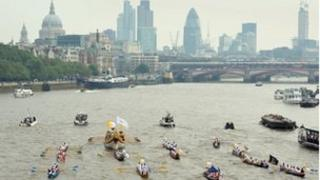 The royal barge Gloriana carrying the Olympic flame on the 70th and final day of the London 2012 Olympic Torch relay
